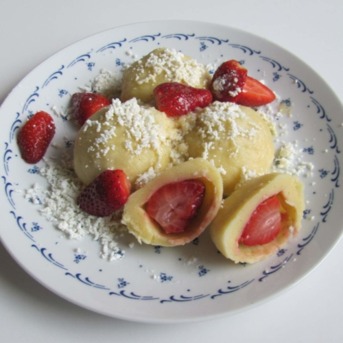 Sweet dumplings made of quark filled with strawberry